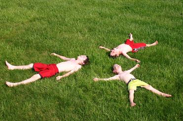 boys having fun in the grass