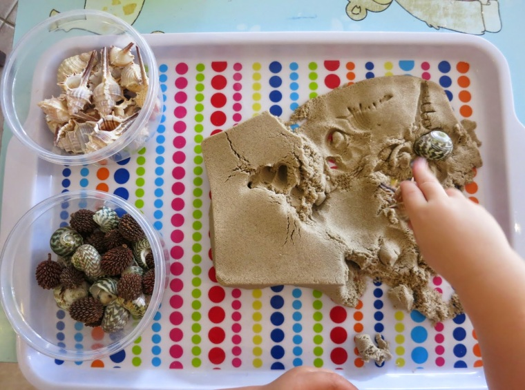 natural materials with kinetic sand