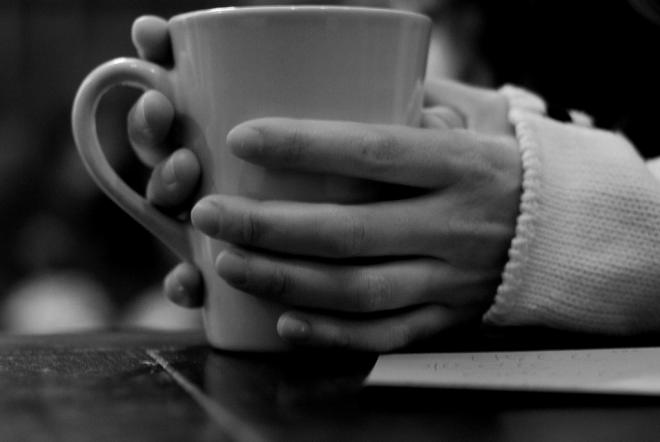 hands-holding-cup-coffee